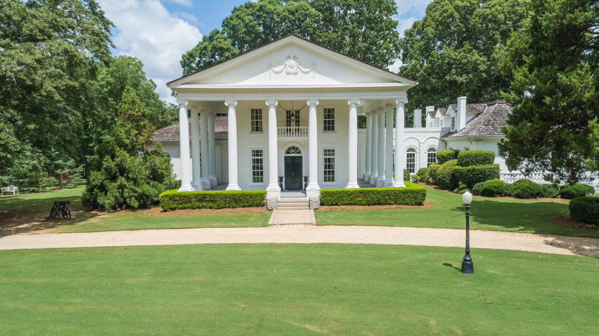 Rustic events venue with manicured lawn at Serenata Farm in Madison, GA