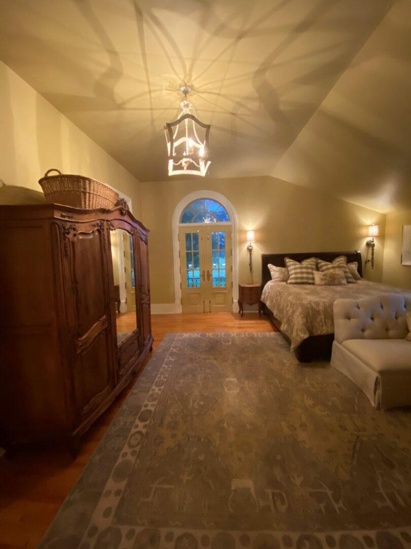 rustic bedroom with arch doorway terrace, Serenata Farm in Madison, GA