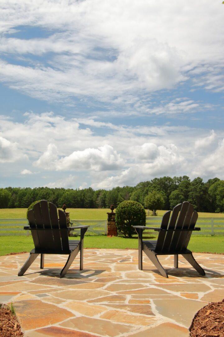 Two yard or lawn chairs facing manicured lawn at Serenata Farm in Madison, GA