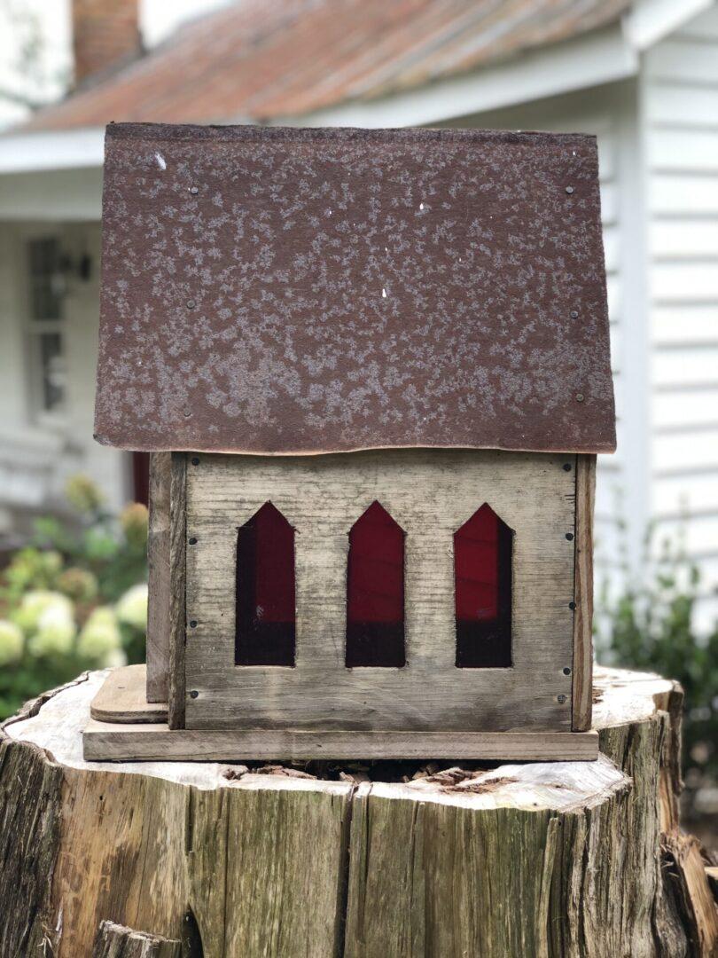 bird house on top of tree stump, Serenata Farm in Madison, GA