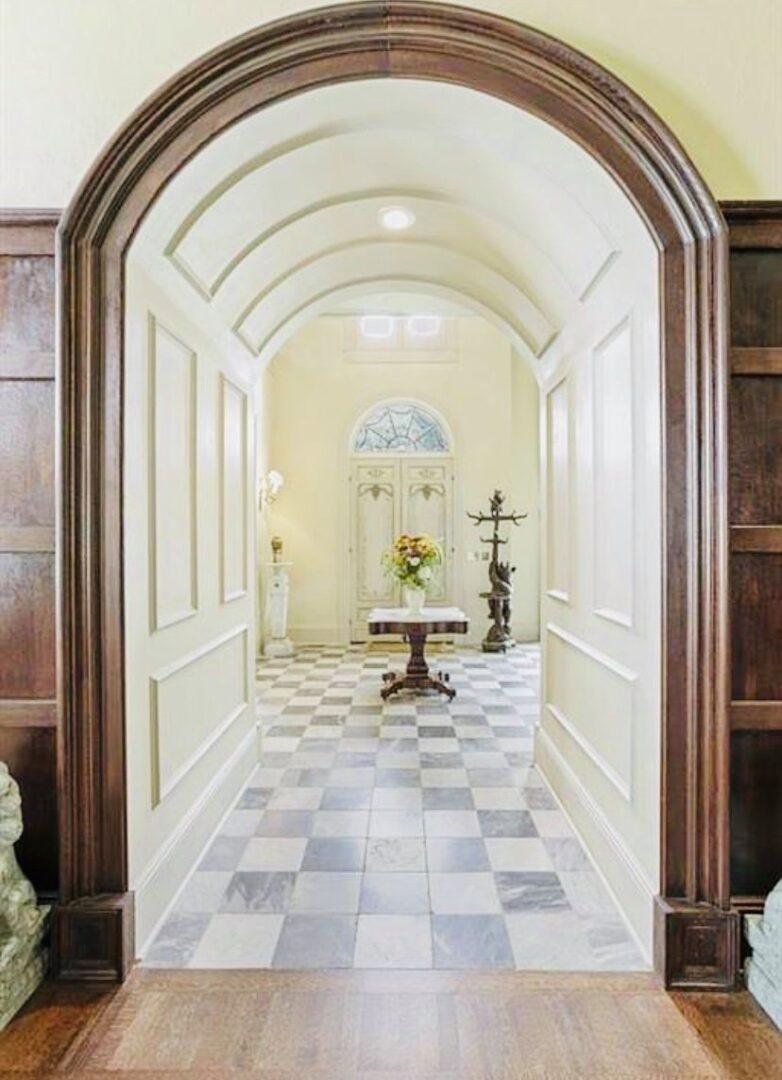 bright, rustic hallway arch inside events venue, Serenata Farm in Madison, GA